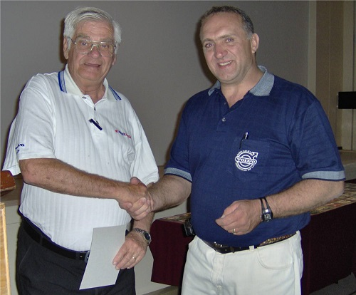 Theo Tamsen receiving his Honorary Life Membership