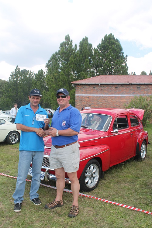Hersel receiving his R500 second prize from Gerhard Campher - the public voted for their favourite Volvo and Tom Campher Motors sponsored the prizes.