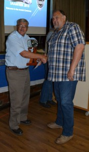 Wouter receiving his award from Honorary Life Member Tou Nel.