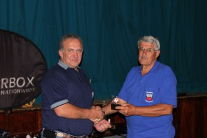 Tou Nel Honorary Life member handing over an award.
